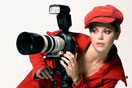 a female photographer with a camera and a tripod
